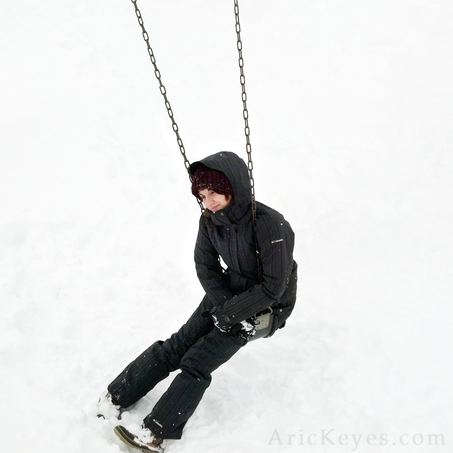 On a swing in the snow